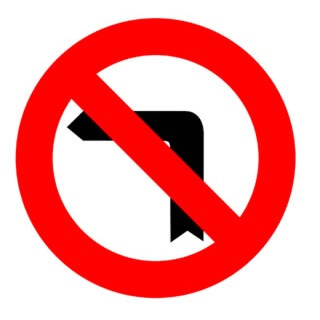 Señal de tráfico prohibido girar a la izquierda